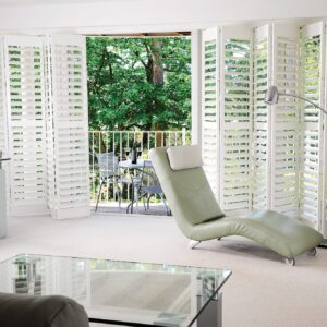 bi fold tracked plantation shutters fitted to external french door