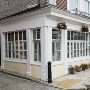 cafe style plantation shutters fitted to shop front