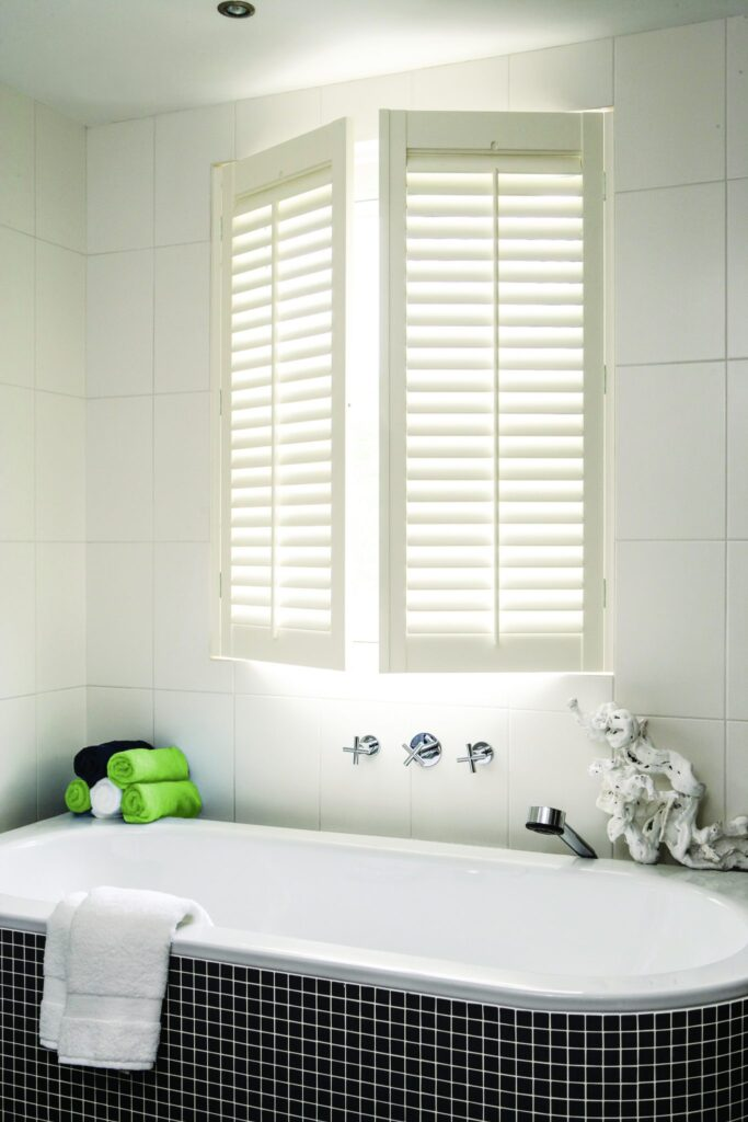 full height window shutters in the bathroom