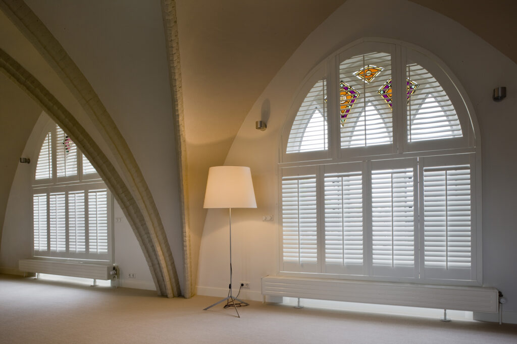 plantation shutter fitted to a arch window